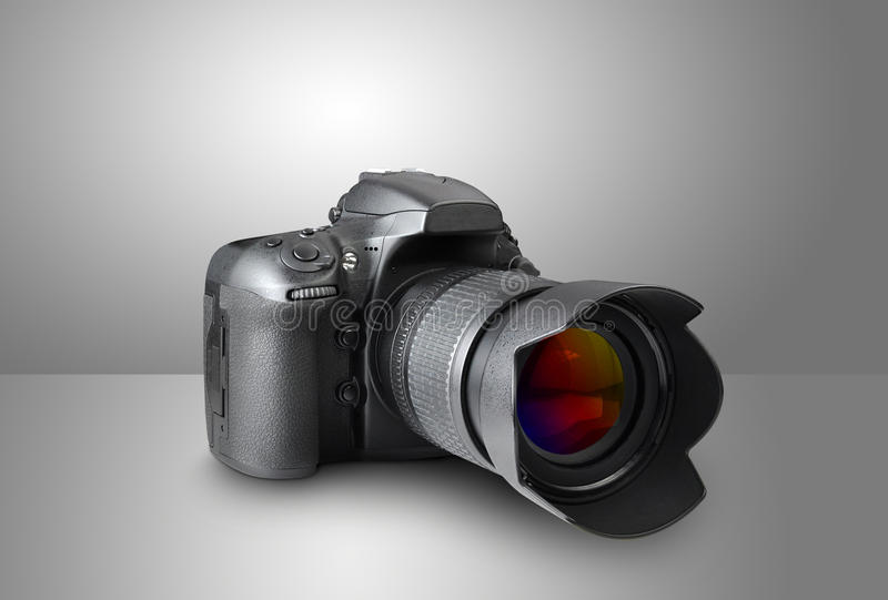 Camera. Digital photo camera on gray background stock images