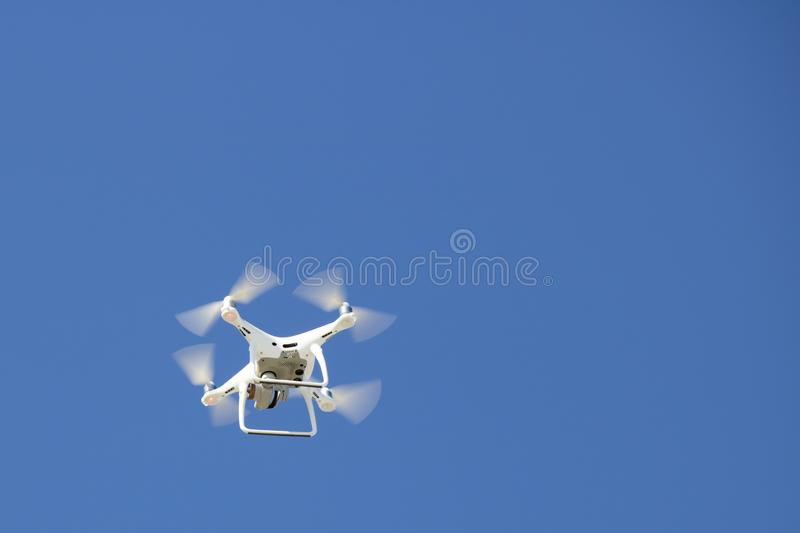 Camera drone close-up in the blue sky royalty free stock photography