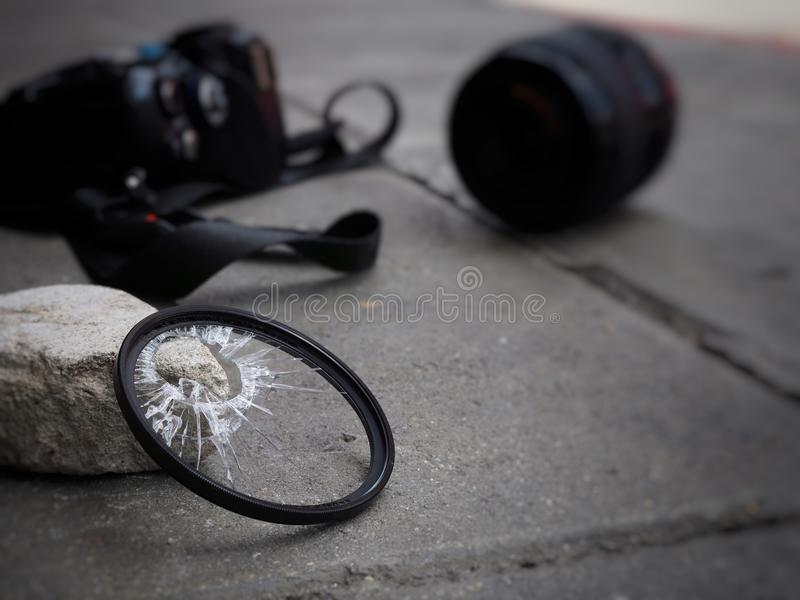 The camera dropped to the ground, causing the filter to break, the len and the body damaged. In the accident insurance concept on. Property royalty free stock photo