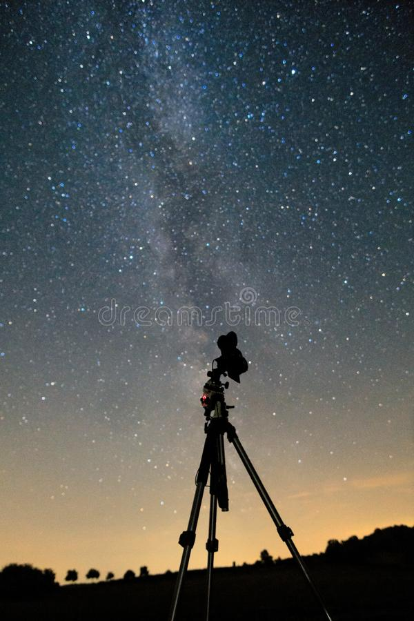 Camera in front of milky way stock images