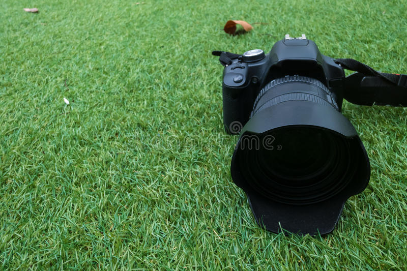 Camera on a grass background royalty free stock photography