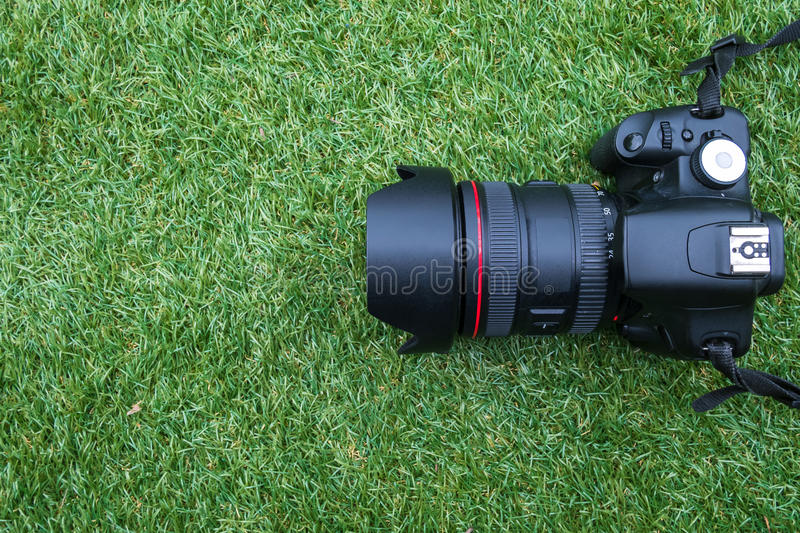 Camera on a grass background stock photo