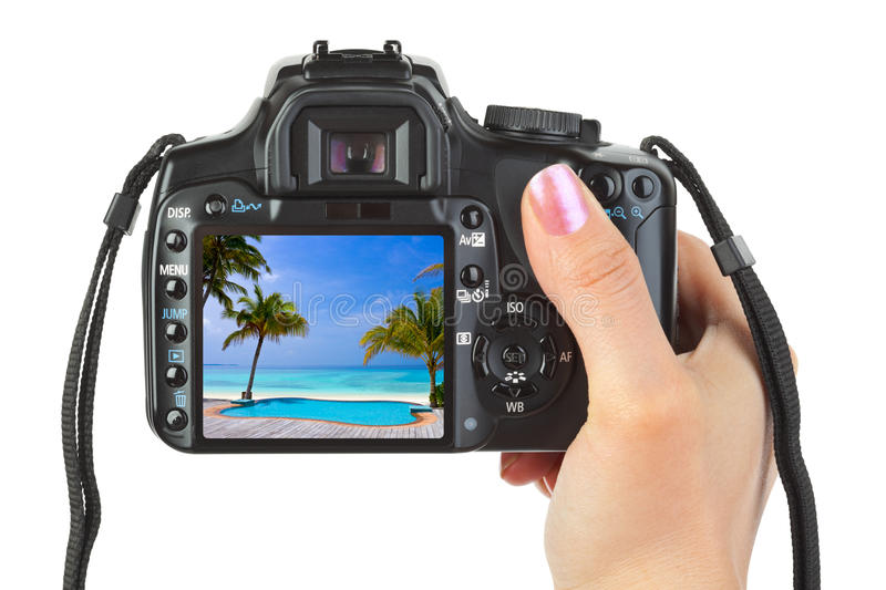 Download Camera In Hand And Beach Landscape Stock Image - Image: 10076175