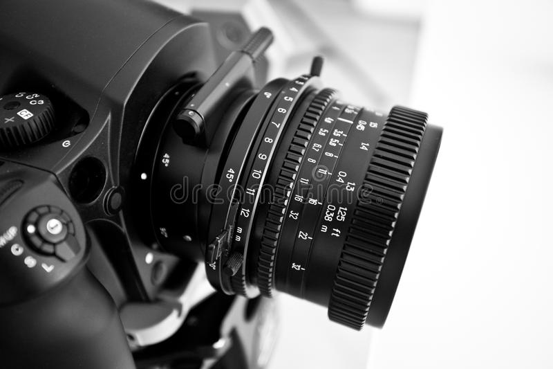 Camera lens. Detail of a camera lens on a camera body royalty free stock photography