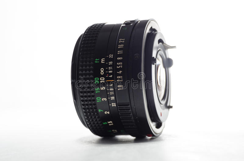 Camera Lens. On white background tilted with black barrel stock image