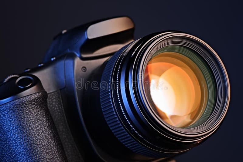 Camera with lens. Close-up of a camera with a lens