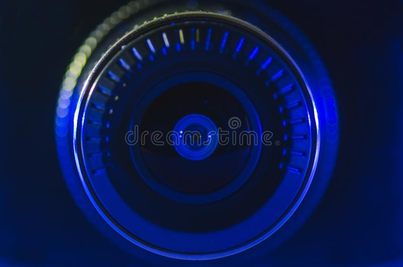 Camera lens with blue color. Approximate, photo, macro stock photography