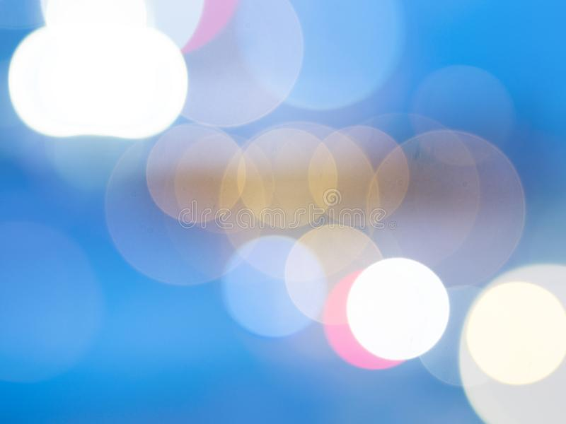 Camera lens bokeh effect on blue background royalty free stock photography