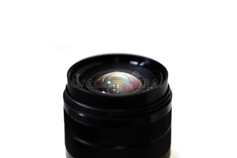Camera lens closeup with color reflection and white background stock images