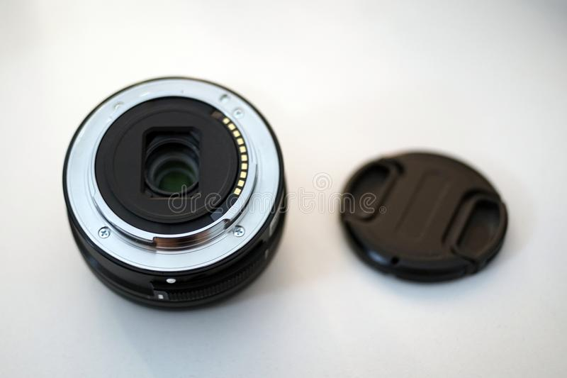 Camera lens and cover cap back side close up stock photography