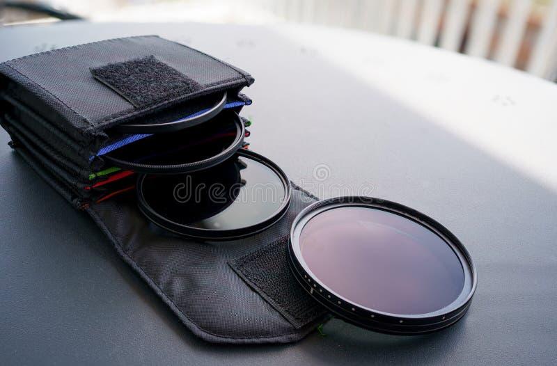 Camera lens filter bag witn Professional variable nd lens filter.  stock photography