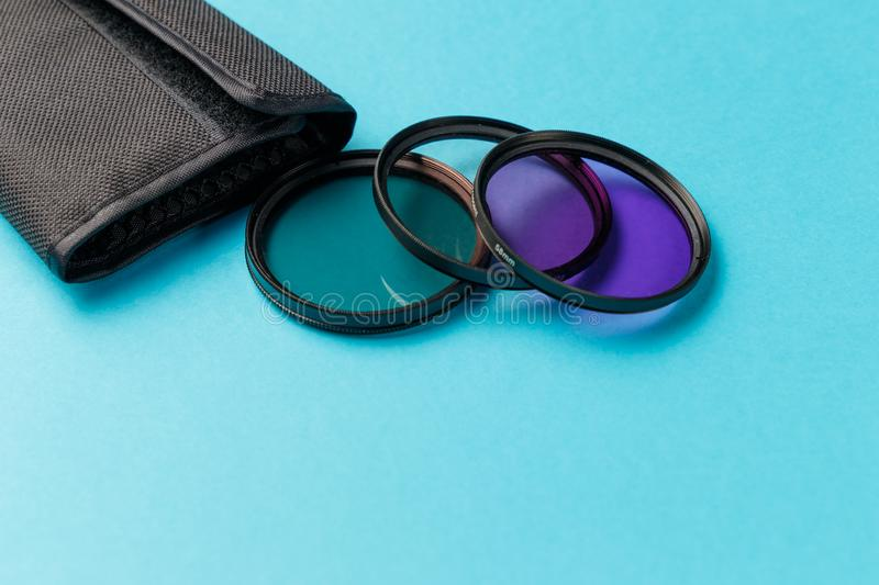 Camera lens filters on blue background. Photo filters. Copy space. Minimal creative concept royalty free stock photo