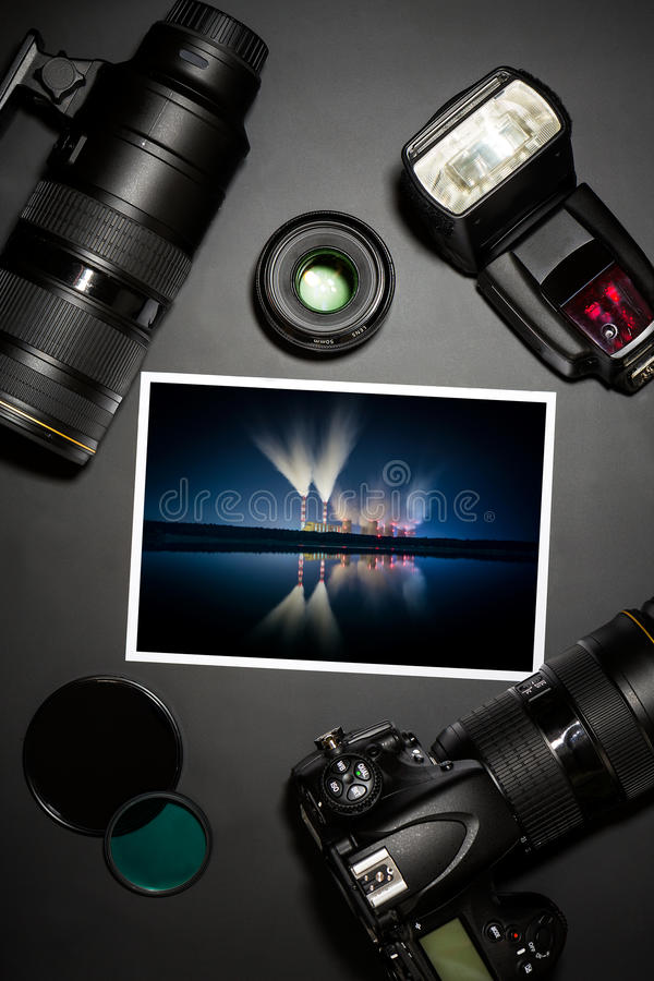 Camera lens and image on black background stock photos