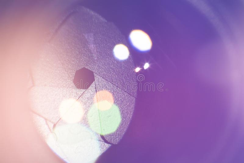 Camera lens with lense reflections. Macro concepts. Light toning royalty free stock images