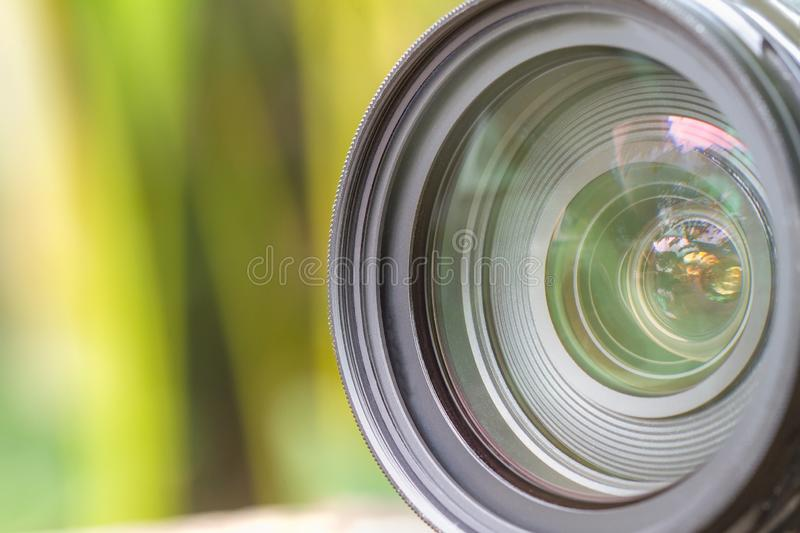 Camera lens with lense reflections modern ultra zoom photo camera stock image