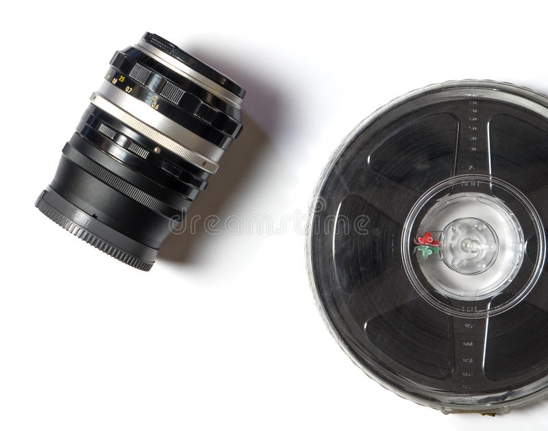 Camera Lens and movie Film strip. On white background royalty free stock photography