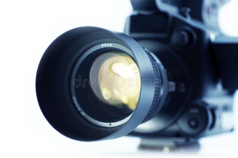 Camera Lens Optics. Video Camera Lens - Video Optics. Videography Equipment. 4/3 Sensor Video Camera Isolated on White. Focus on the Lens stock photography