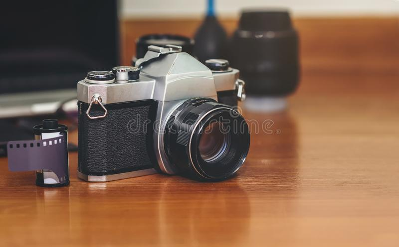 Camera, lens and photographer equipment that is ready to work on the wooden royalty free stock photos