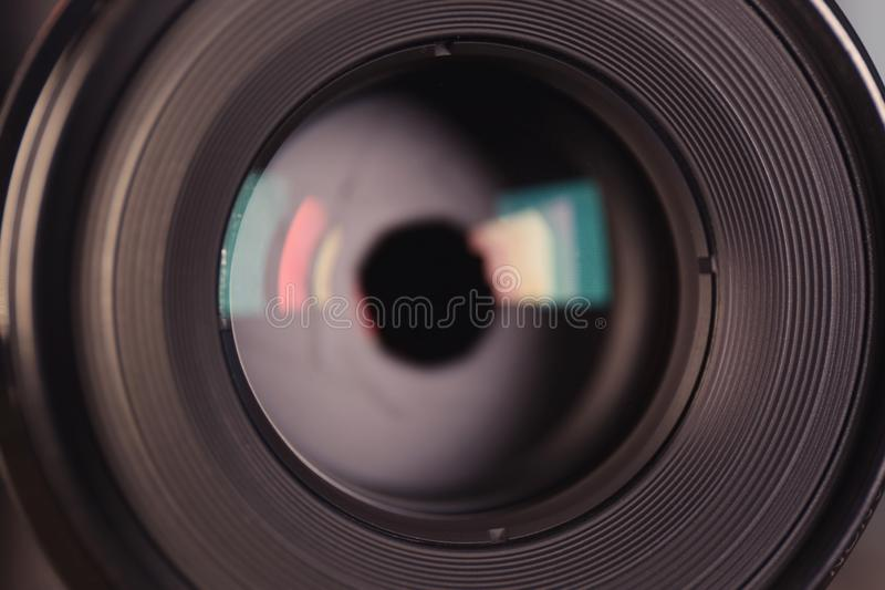 Camera lens of professional photographer. Closeup view royalty free stock photography