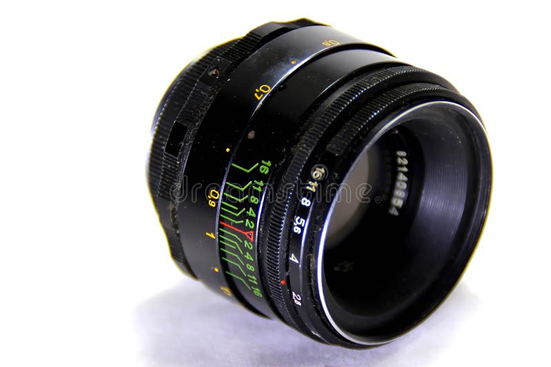 The camera lens on a white background. The old Soviet camera lens on a white background stock photos