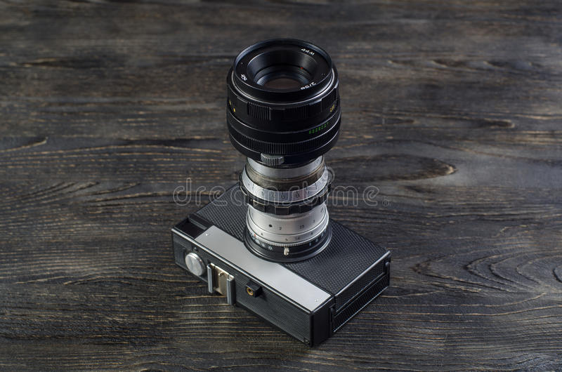 Camera lenses on a wooden background stock images
