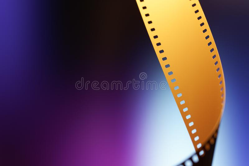 35 mm Motion Picture Film. Camera negative film. Selective focus on film perforation. Unprocessed color motion picture film. Industry symbol for shooting process stock image