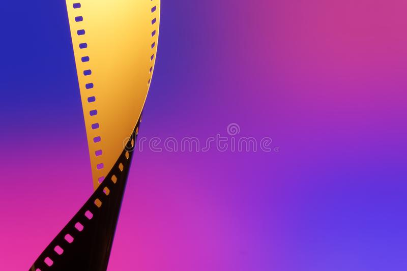 35 mm Motion Picture Film. Camera negative film. Selective focus on film perforation. Unprocessed color motion picture film. Industry symbol for shooting process stock images