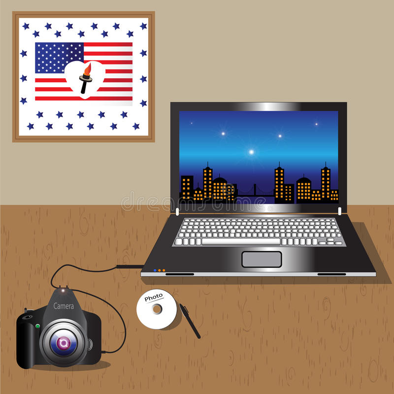 Camera and the notebook. On the desk is a laptop, and it is connected to the camera by USB wire to transmit photos. This wall weighs painting with American flag stock illustration