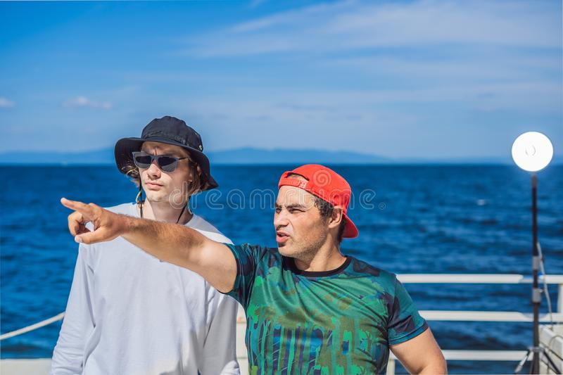 Camera operator, director and dp discuss the process of a commercial video shoot.  stock images