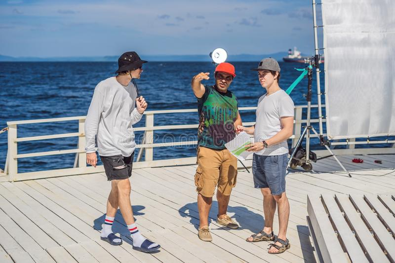 Camera operator, director and dp discuss the process of a commercial video shoot.  royalty free stock photos