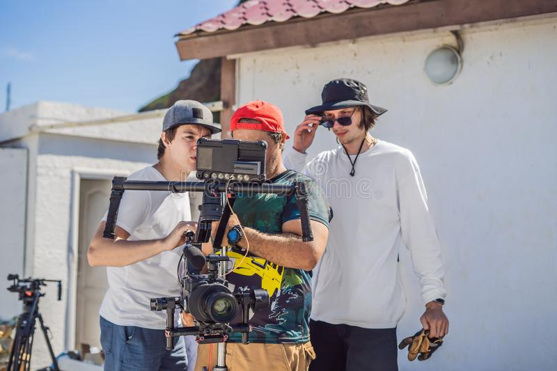 Camera operator, director and dp discuss the process of a commercial video shoot.  royalty free stock photography