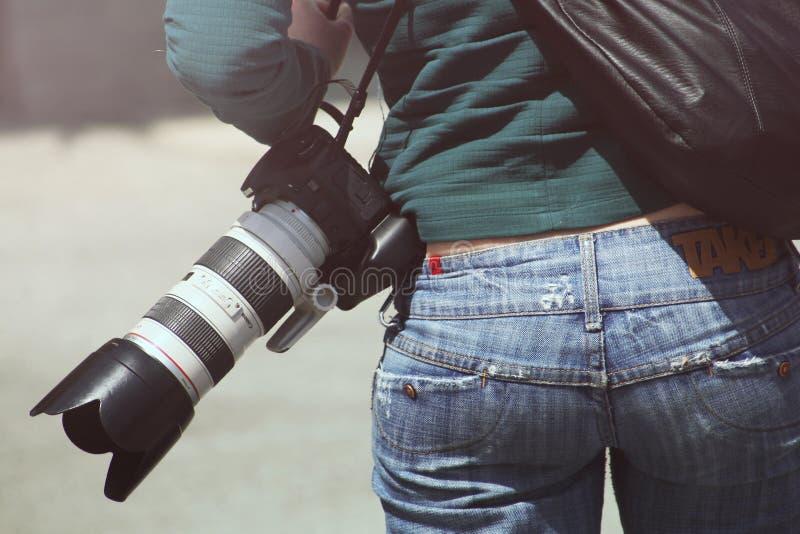 Camera on photographer royalty free stock photography