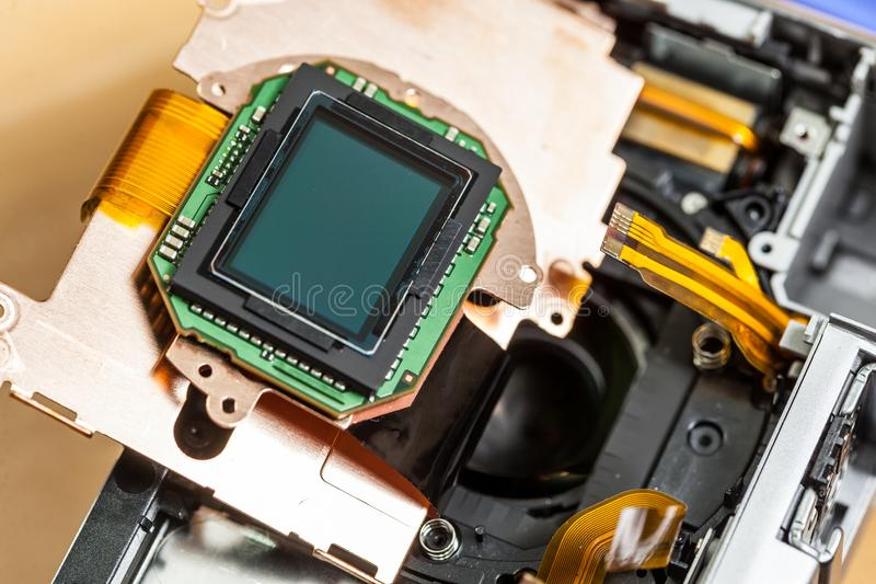 Camera sensor matrix close up. Camera inside, parts of sensor matrix close up. Fixing technology modern device royalty free stock photos