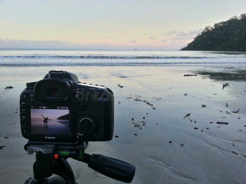 Camera Showing Person On An Empty Beach At Sunset ...