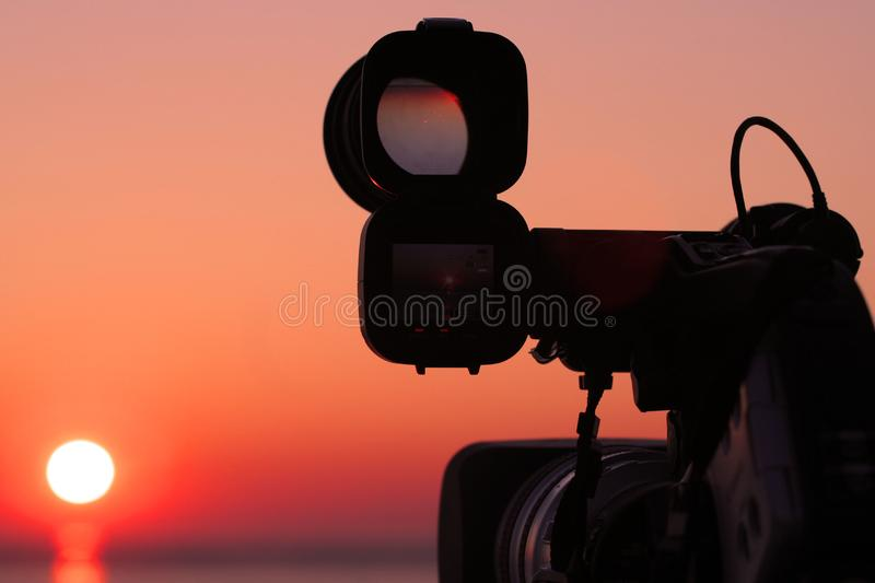 Camera and the sun - face to face royalty free stock photography