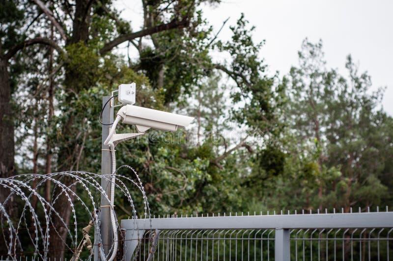 Camera surveillance fence. Modern methods of supervision stock photos