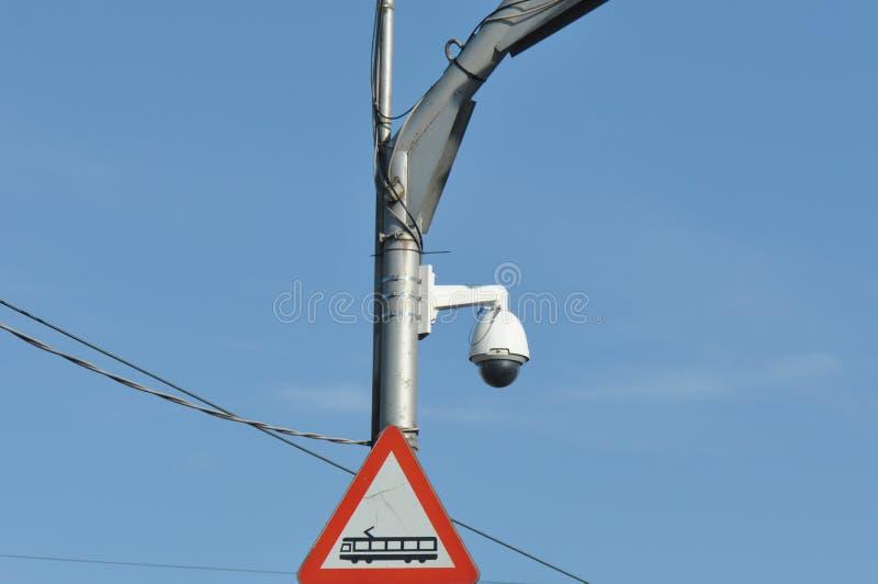 Camera surveillance from traffic. Camera surveillance on pillar near road for traffic monitoring royalty free stock photos