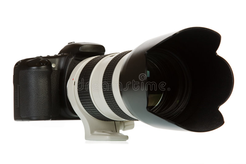 Camera and telelens. Digital camera isolated on white background royalty free stock images