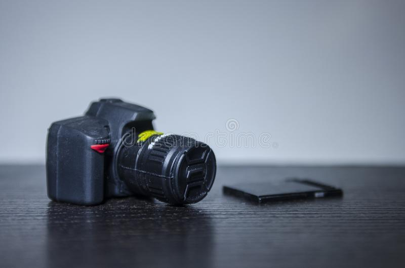 A camera toy with a memory card stock photos