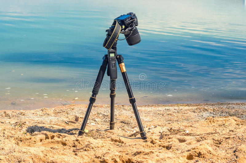 Camera on a tripod near the seaside stock images