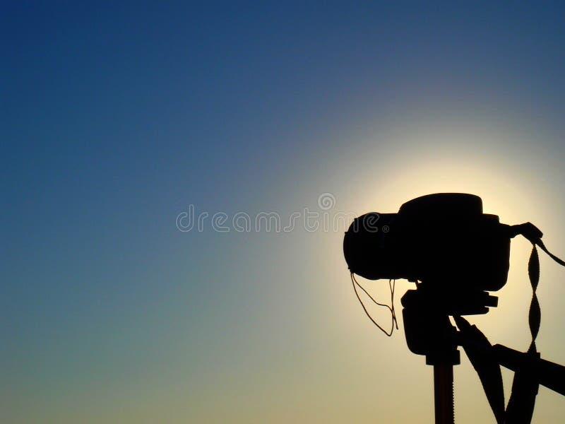 Camera on tripod silhouette stock photo