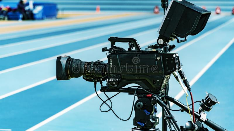Camera, TV broadcast on olympic track. 4K broadcasting camera royalty free stock images