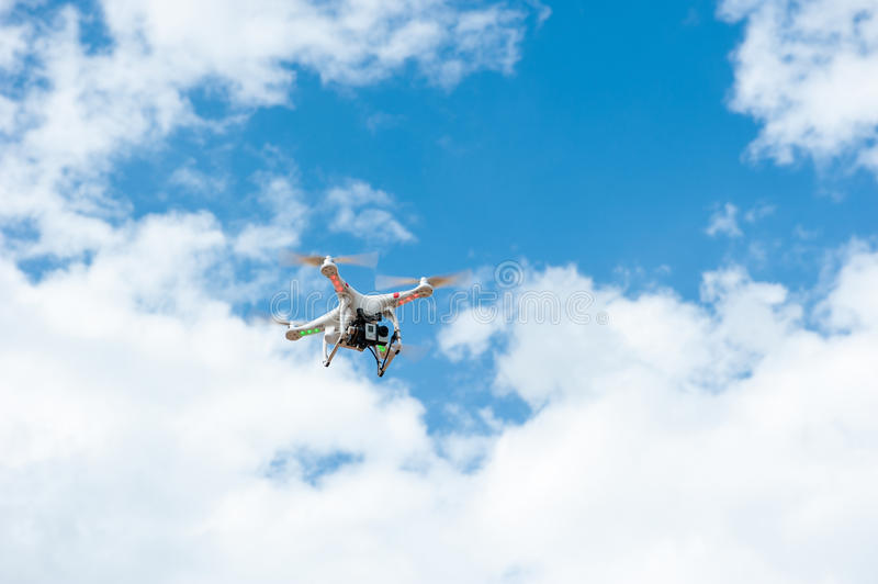 Camera white drone hovering stock photo