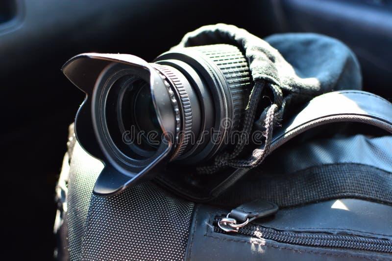 Camera lense and a photo bag royalty free stock photography