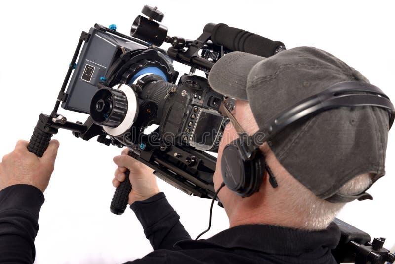 Cameraman. Man equip a helmet with a handheld camera stock image