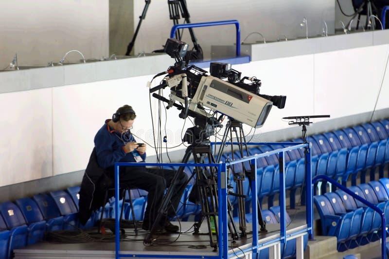 Cameraman with broadcast camera stock image