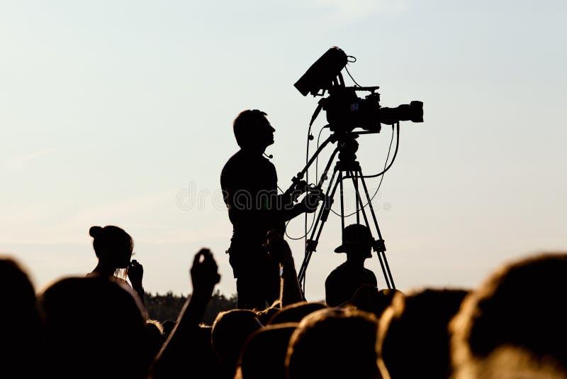 Cameraman die een levend overleg schieten royalty-vrije stock foto