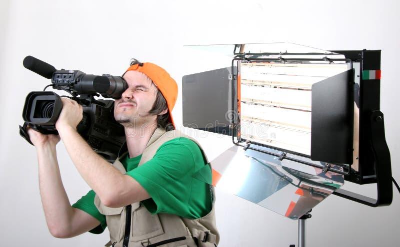 Cameraman die met licht is ontsproten stock fotografie