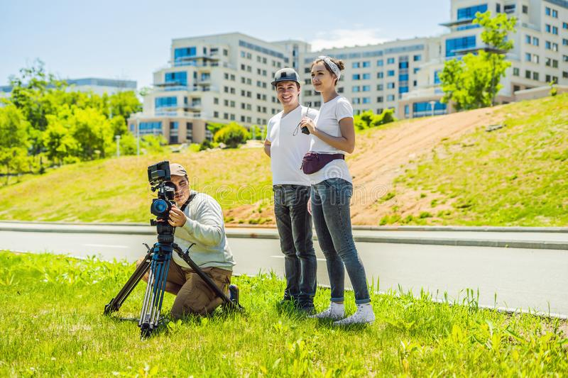Cameraman, director and asistant on a cinema, commercial production exterior set.  royalty free stock photos