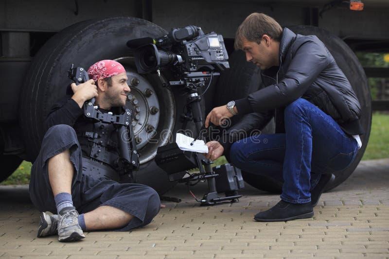 Cameraman en directeur stock afbeelding